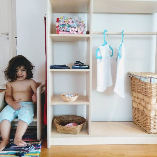 Independence Chair with a boy and on the right an Independence Wardrobe
